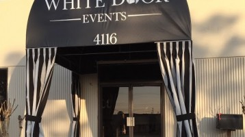 white door events awning